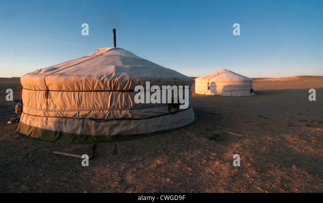 nomadic gers at sunrise in the Gobi Desert of Mongolia - Stock-Bilder