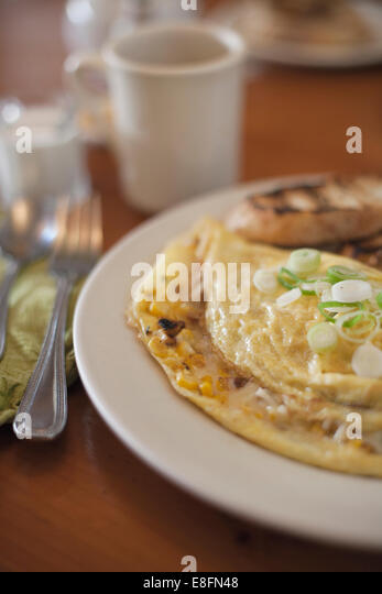 Close-up of cheese and onion omelette breakfast with toast - Stock Image