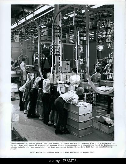 1962 - Loop-the-loop Telephone production line enthralls young artists at Western Electric Indianapolis Works. They - Stock Image