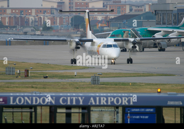 Airplane taxiing at London City Airport UK - Stock Image