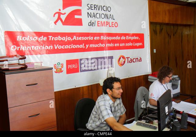 Peru Tacna Avenida Cusco government office Hispanic man woman banner Spanish Employment Ministry agency worker staff - Stock Image