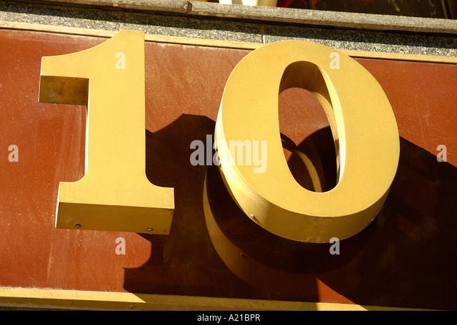 DOOR NUMBER TEN 10 ON WALL BACKGROUND - Stock Image