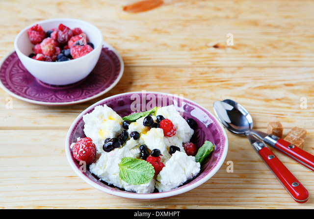 breakfast cottage cheese and berries, food closeup - Stock Image