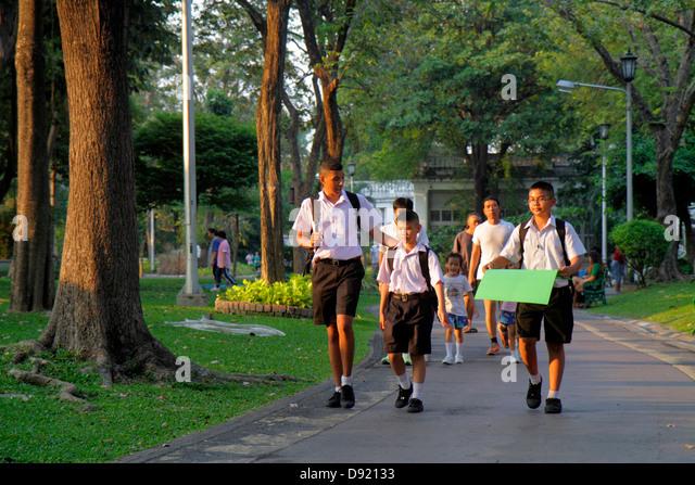 Bangkok Thailand Phra Nakhon Saranrom Park Asian teen boy student walking school uniform - Stock Image