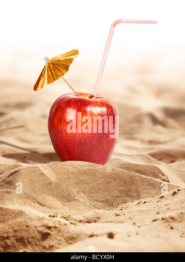 Apple cocktail in a hot desert - Stock Image