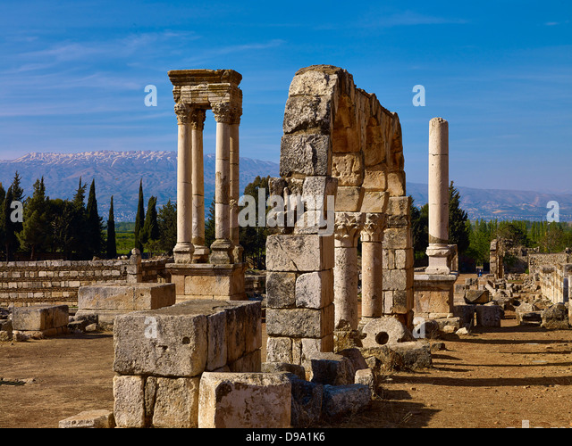Lebanon Mountains and tetrapylon of the ancient city Anjar, also Haoush Mousa, Lebanon, Middle East - Stock Image