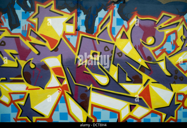 Graffiti; Tagged Wall Mural - Stock Image