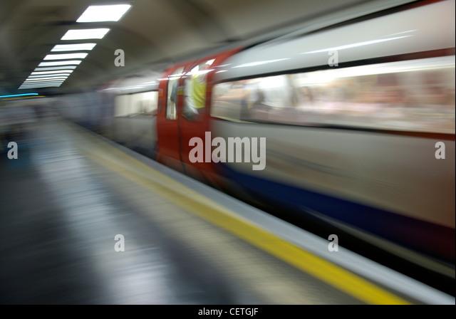 An underground train leaving the platform. - Stock-Bilder
