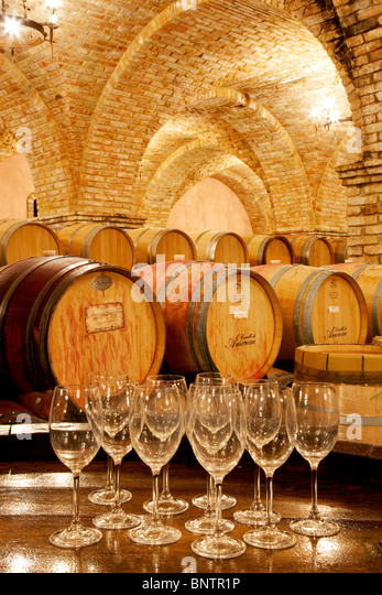 Wine aging in barrels in cellar with wine glasses. Castello di Amorosa. Napa Valley, California. Property released - Stock-Bilder