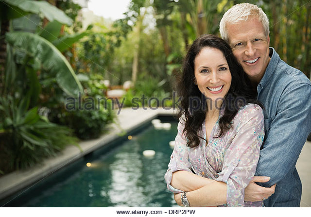 Portrait of affectionate couple embracing outdoors - Stock-Bilder