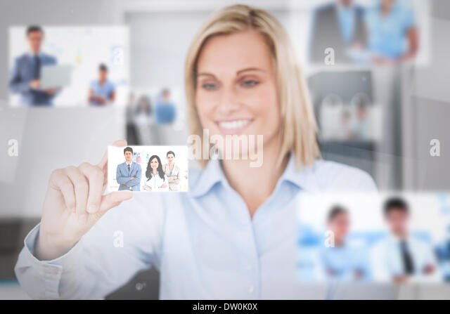 Joyful attractive woman catching a picture - Stock Image