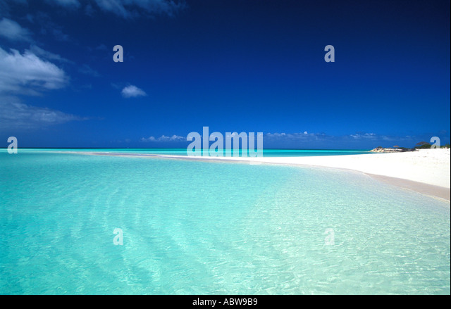 Tropical beach spit of sand clear water and deep blue sky Los Roques Venezuela - Stock Image