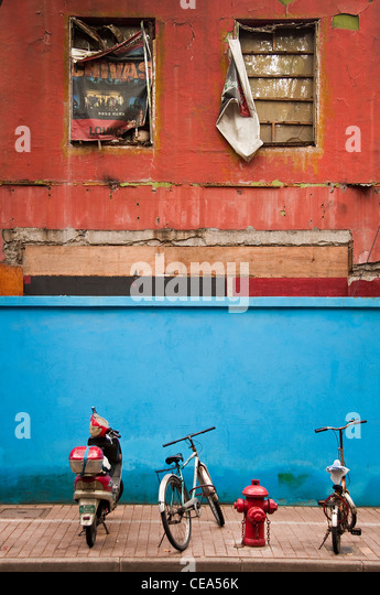 Bicycles parked in a street of the French Concession - Shanghai, China - Stock Image