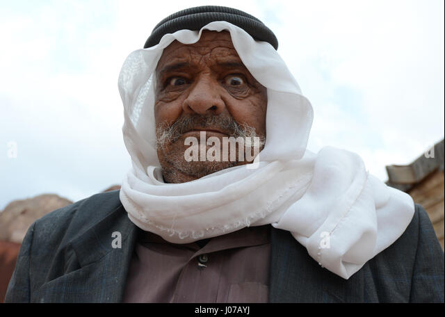 Portrait of a Bedouin man making funny faces. - Stock Image
