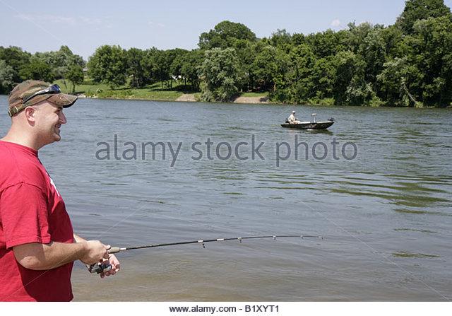 Arkansas Ozark Mountains Allison White River man freshwater fishing angler shore boat rod reel recreation sport - Stock Image