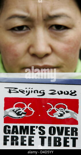 A member of German NGO 'David gegen Goliath e.V.' protests on the Chinese actions against Tibet at the Marien - Stock Image