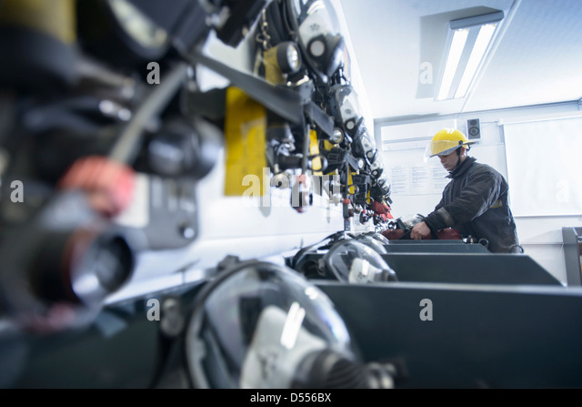 Firefighter in training room - Stock Image