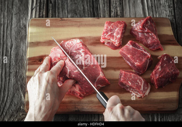 Cutting angus beef on the wooden table horizontal - Stock Image