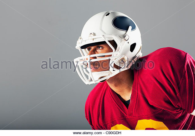 Football player wearing helmet - Stock Image