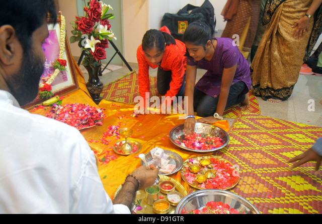 Singapore Little India Serangoon Road Amriteswari Society Hindu religion Hindus service Asian girl teen flower petals - Stock Image
