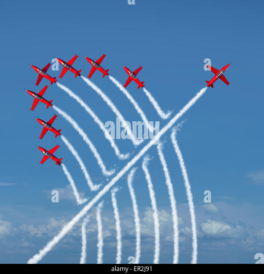 Disruptive innovation Independent leadership concept and individuality as a group of acrobatic jets with one individual - Stock Image