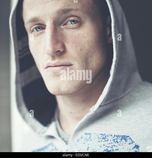 Portrait of freckled young man - Stock Image