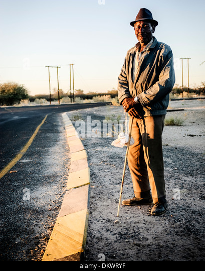 Maun, Botswana African man standing by the road. - Stock-Bilder