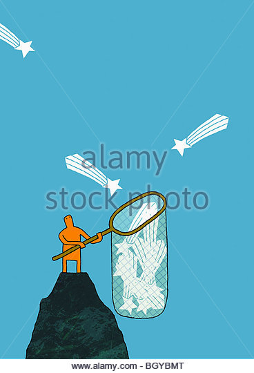 Man catching shooting stars - Stock Image