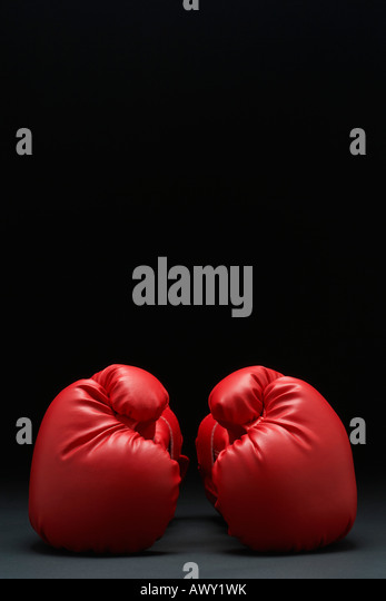 Pair of red boxing gloves - Stock Image