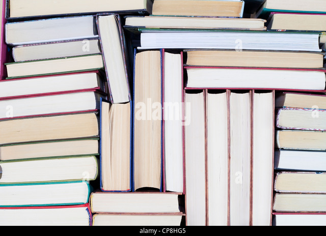Old dirty books on book shelf background - Stock Image