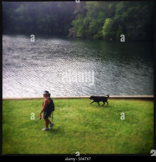 Woman walking her dog in Tallulah gorge state park in Georgia, USA - Stock Image