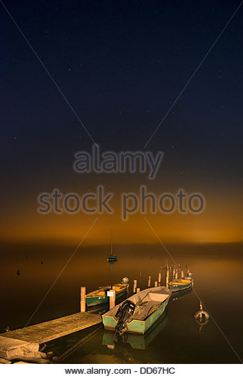 Germany, View of wooden jetty with boat in lake constance - Stock Image