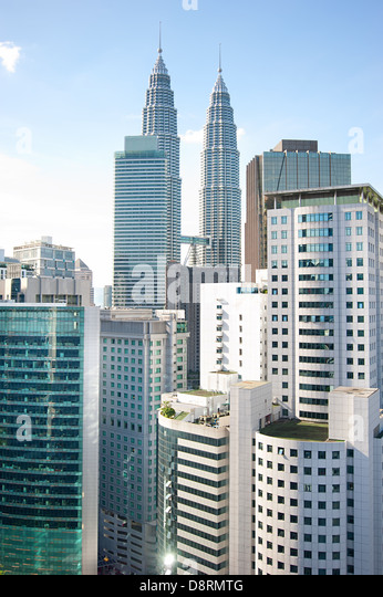 Architecture of Kuala Lumpur with famous Petronas Twin Towers. - Stock Image