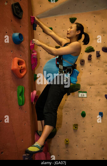 pregnant woman climbing, 8 1/2 months, Maryland, Model released - Stock Image