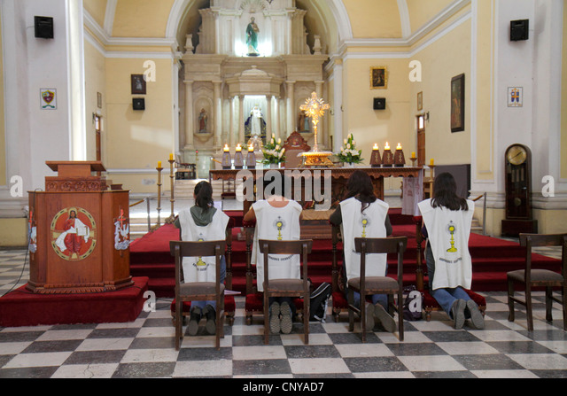 Peru Tacna Avenida San Martin La Catedral de Tacna cathedral church Catholicism religion praying kneeling Hispanic - Stock Image