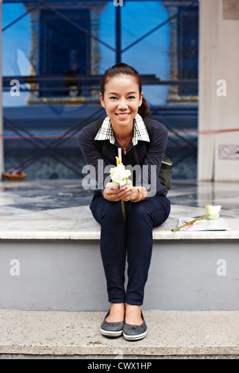 Woman sitting on urban steps - Stock Image