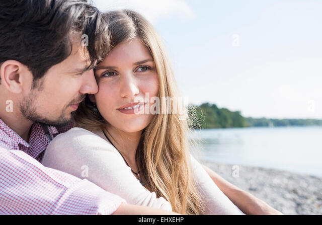 Portrait loving young couple lake romantic - Stock-Bilder