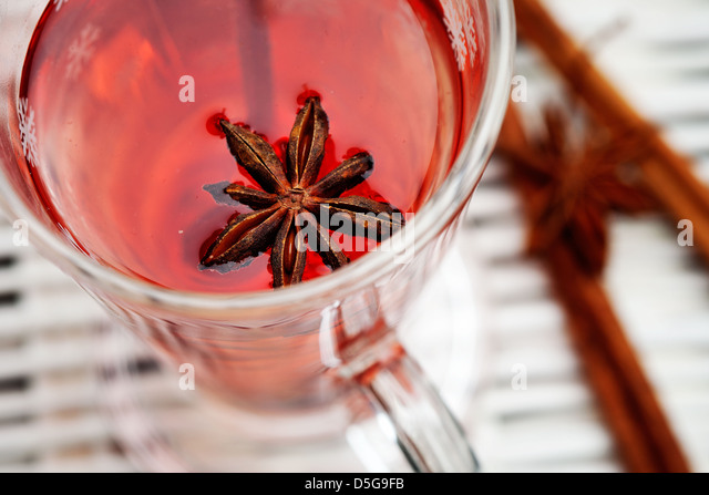 Mulled wine with cinnamon stick and star anise - Stock Image