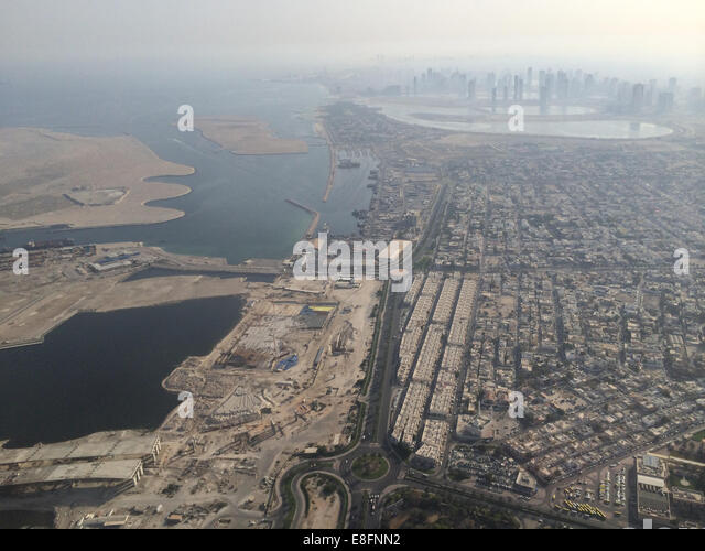 United Arab Emirates, Dubai, Aerial view of construction site and skyscrapers in background - Stock Image