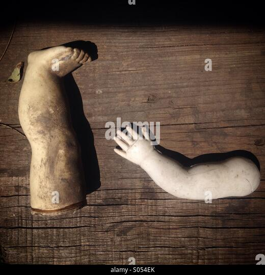 An arm and a leg of a doll in the Island of the Dolls, Xochimilco, Mexico City, Mexico - Stock Image