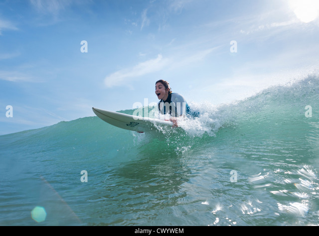 Woman having fun surfing. - Stock Image