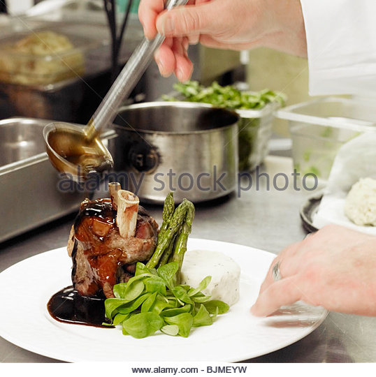 Chef Preparing Beef Shank with Asparagus - Stock Image