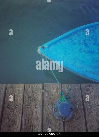 Moored boat by the pier - Stock Image