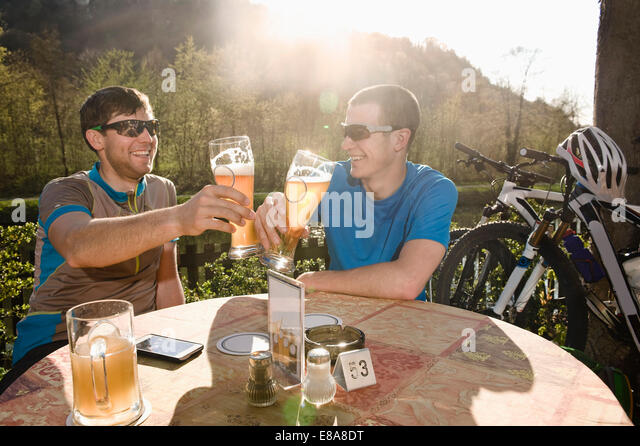 Young men drinking beer, Bavaria, Germany - Stock Image