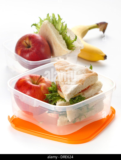 Lunch box with sandwich and apple on white background - Stock-Bilder