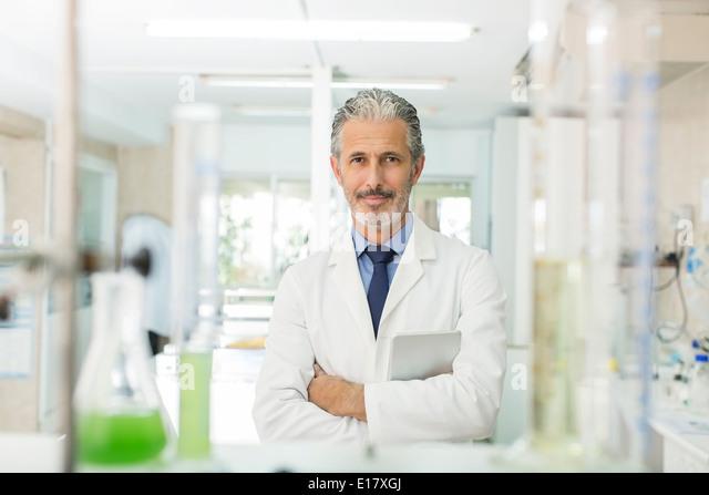 Portrait of confident scientist in laboratory - Stock Image