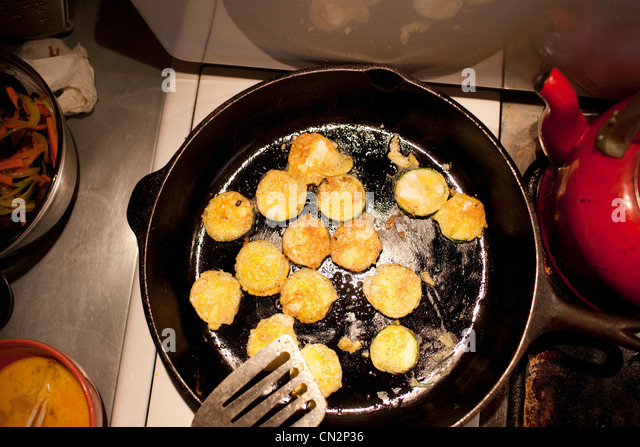 Courgette in frying pan - Stock Image