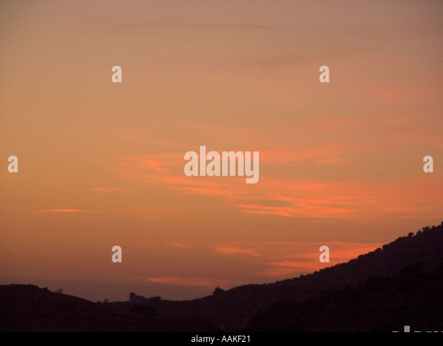 SPAIN Sunset over the Sierra de Tejeda mountains   in the Axarquía region of Southern Spain Europe Spanish - Stock Image