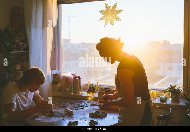Finland, Helsinki, Couple preparing christmas cookies - Stock Image