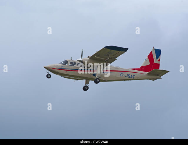 Britten Norman BN-2T Turbine Islander leaving Inverness Airport, Scotland.  SCO 11,249. - Stock Image